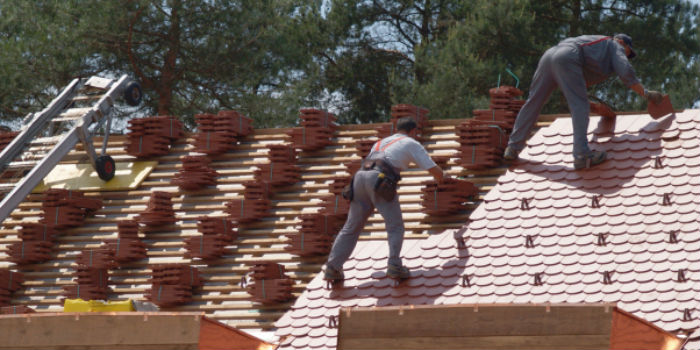 Roofers On The Roof Arrange Tiles